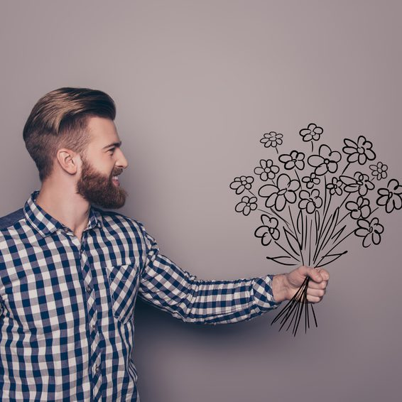 Smiling bearded man holding bouqet of flowers to his girlfriend